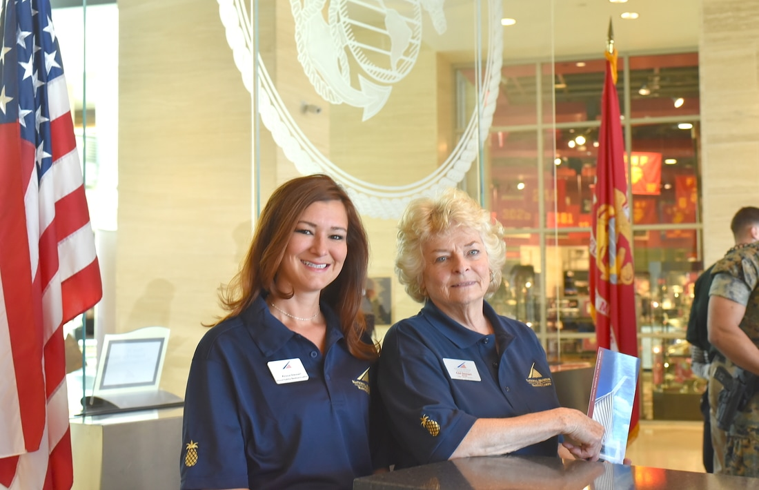 Ambassadors at the front desk of the Museum